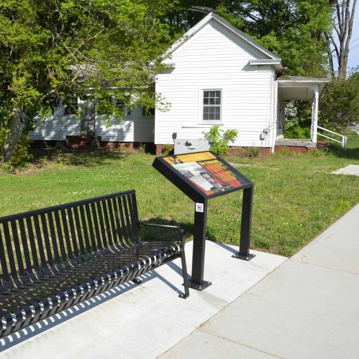 Park Bench and History Sign in Morrisville